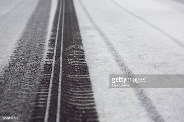 Tyre tracks on snow covered road