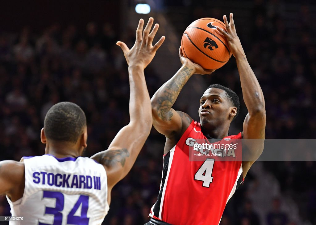 Tyree Crump #4 of the Georgia Bulldogs puts up a shot against Levi Stockard III #34 of the Kansas State Wildcats during the first half on January 27, 2018 at Bramlage Coliseum in Manhattan, Kansas.