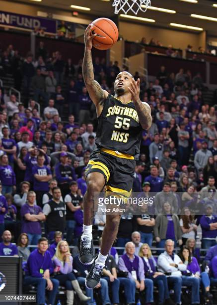 Tyree Griffin of the Southern Miss Golden Eagles drives to the basket for a lay up during the first half against the Kansas State Wildcats on...