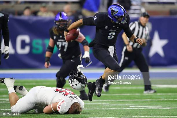 Tyree Jackson of the Buffalo Bulls breaks the tackle of Weston Kramer of the Northern Illinois Huskies in the first half during the MAC Championship...
