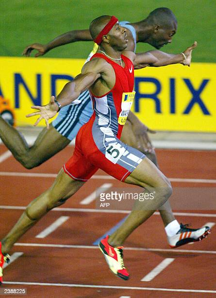Tyree Washington of the US celebrates winning the 400m ahead of Michael Blackwood of Jamaica at the Norwich Union London Grand Prix in London 08...