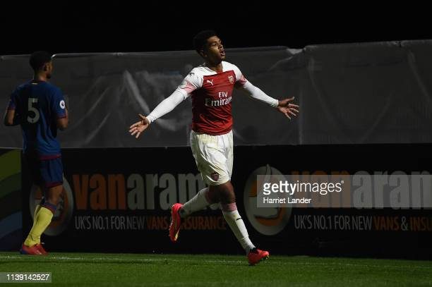 Tyreece JohnJules celebrates after scoring his team's first goal during the Premier League 2 match between Arsenal and West Ham United at Meadow Park...