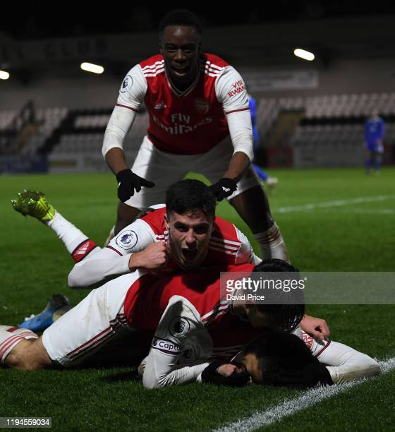 Tyreece JohnJules celebrates scoring Arsenal's 3rd goal with James Olayinka Robbis Burton and Jordan McEneff during the Premier League International...