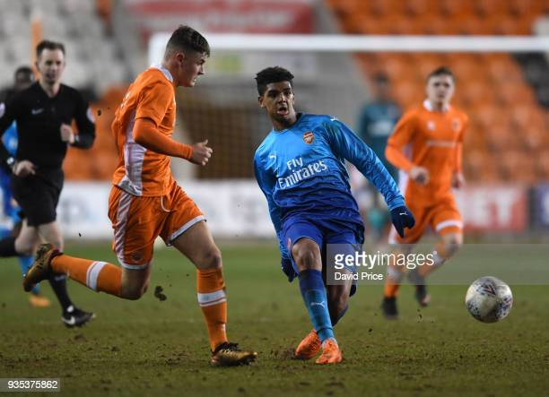 Tyreece JohnJules of Arsenal passes the ball under Jack Newton of Blackpool during the match between Blackpool and Arsenal at Bloomfield Road on...
