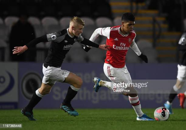 Tyreece JohnJules of Arsenal takes on Jordan Brown of Derby during the Premier League 2 game between Arsenal FC and Derby County at Meadow Park on...