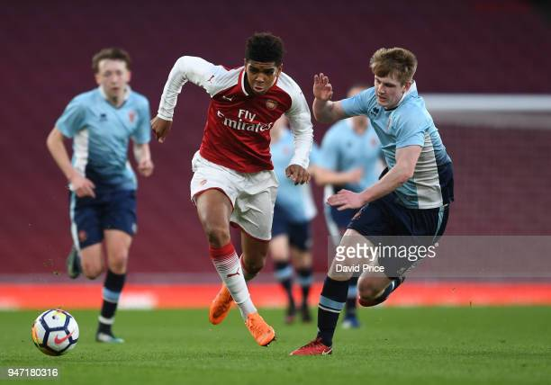 Tyreece JohnJules of Arsenal takes on Will Avon of Blackpool during the match between Arsenal and Blackpool at Emirates Stadium on April 16 2018 in...