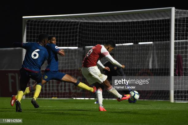 Tyreece JohnJules scores his team's first goal during the Premier League 2 match between Arsenal and West Ham United at Meadow Park on March 29 2019...