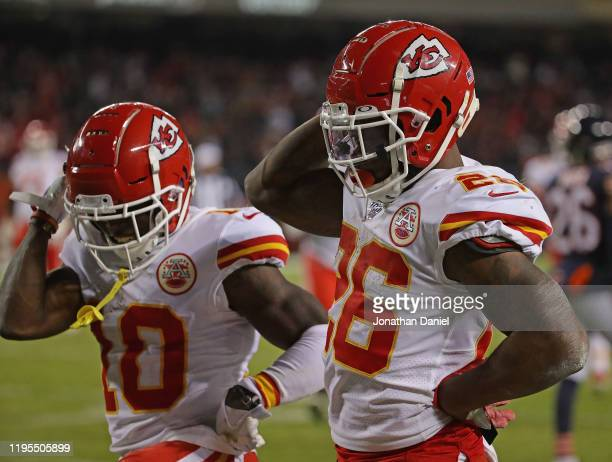 Tyreek Hill and Damien Williams of the Kansas City Chiefs celebrate a touchdown run by Williams against the Chicago Bears at Soldier Field on...