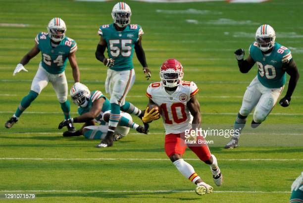Tyreek Hill of the Kansas City Chiefs carries the ball against the Miami Dolphins during the first half of the game at Hard Rock Stadium on December...