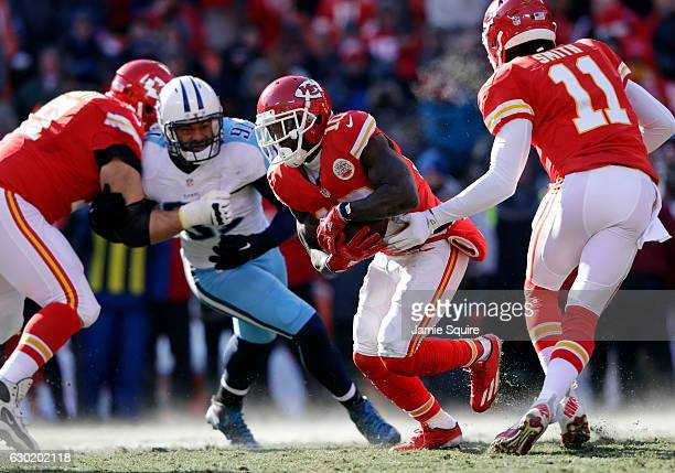 Tyreek Hill of the Kansas City Chiefs carries the ball off a hand of by quarterback Alex Smith for a touchdown on the Chiefs second play from...