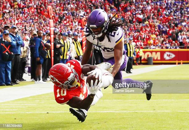 Tyreek Hill of the Kansas City Chiefs catches a 40-yard touchdown pass against Trae Waynes of the Minnesota Vikings during the first quarter at...