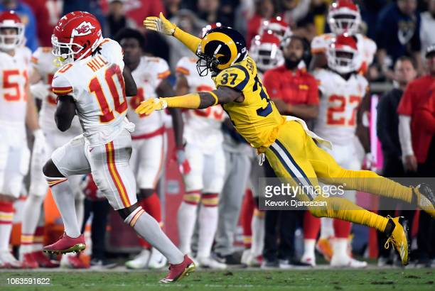 Tyreek Hill of the Kansas City Chiefs catches a first down catch in front of Sam Shields of the Los Angeles Rams during the second quarter of the...