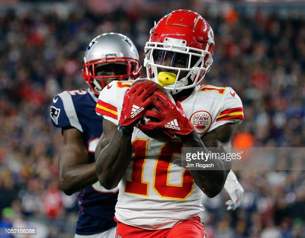 Tyreek Hill of the Kansas City Chiefs catches a touchdown pass against the defense of Devin McCourty of the New England Patriots in the third quarter...