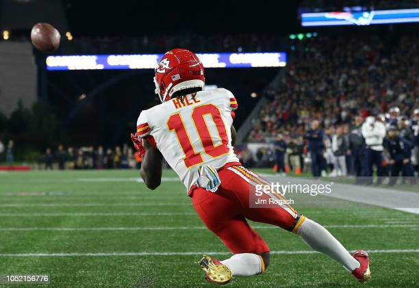 Tyreek Hill of the Kansas City Chiefs catches a touchdown pass against the New England Patriots in the fourth quarter at Gillette Stadium on October...
