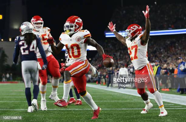 Tyreek Hill of the Kansas City Chiefs celebrates a touchdown pass with Kareem Hunt of the Kansas City Chiefs against the New England Patriots in the...