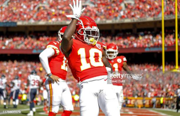 Tyreek Hill of the Kansas City Chiefs celebrates after his third quarter touchdown reception against the Houston Texans at Arrowhead Stadium on...