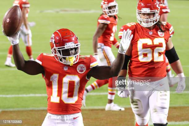 Tyreek Hill of the Kansas City Chiefs celebrates after scoring a touchdown against the New England Patriots during the second half at Arrowhead...