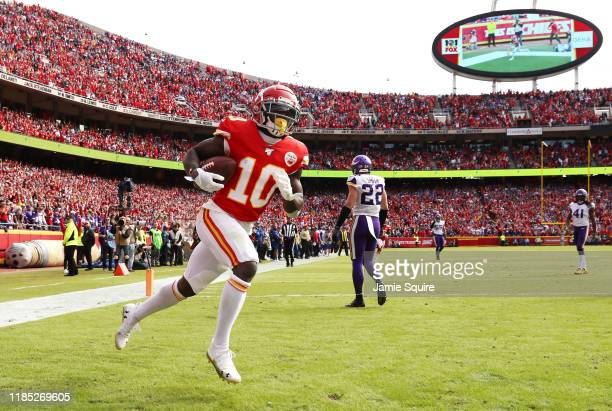 Tyreek Hill of the Kansas City Chiefs celebrates catching a 40yard touchdown pass against the Minnesota Vikings during the first quarter at Arrowhead...