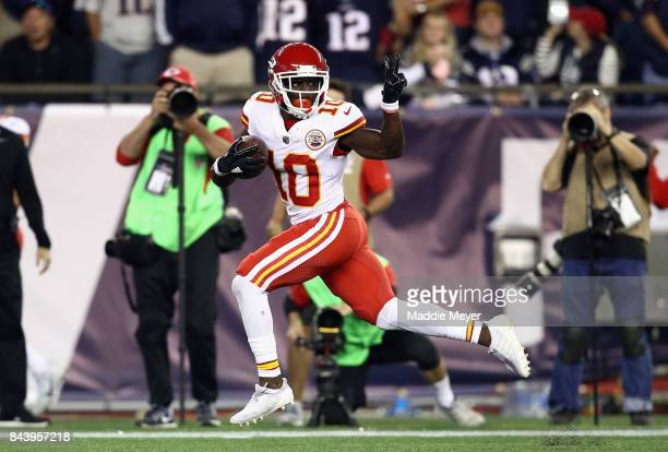 Tyreek Hill of the Kansas City Chiefs celebrates on his way to scoring a touchdown during the third quarter against the New England Patriots at...