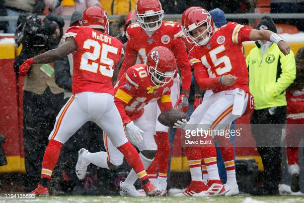Tyreek Hill of the Kansas City Chiefs celebrates with teammates after a 41yard touchdown against the Denver Broncos in the game at Arrowhead Stadium...