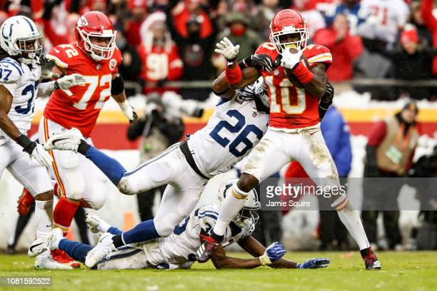 Tyreek Hill of the Kansas City Chiefs crosses the goal line for the games second touchdown while running through the tackle attempt of Clayton...