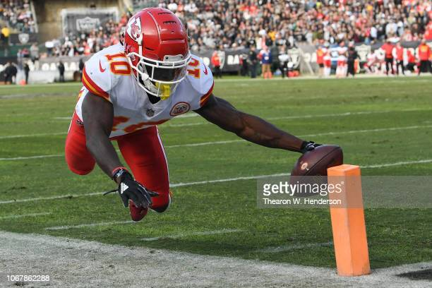 Tyreek Hill of the Kansas City Chiefs dives short of the end zone against the Oakland Raiders during their NFL game at OaklandAlameda County Coliseum...
