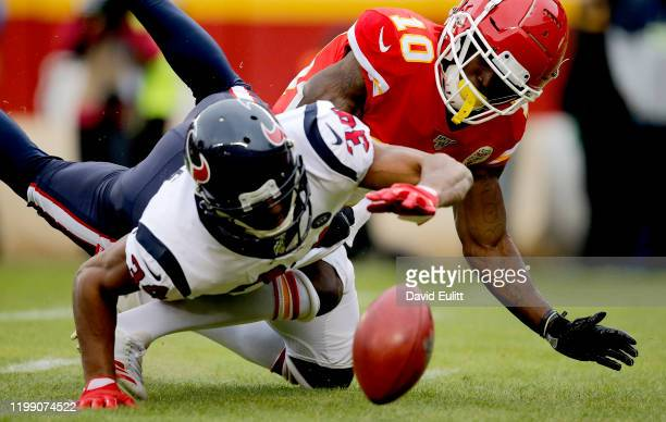 Tyreek Hill of the Kansas City Chiefs fumbles on a punt return that Taiwan Jones of the Houston Texans attempts to recover during the AFC Divisional...