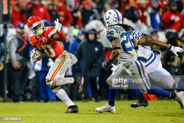 Tyreek Hill of the Kansas City Chiefs gestures to the trailing Clayton Geathers of the Indianapolis Colts during the third quarter of the AFC...