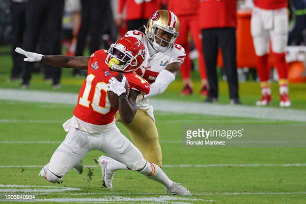Tyreek Hill of the Kansas City Chiefs is tackled by Richard Sherman of the San Francisco 49ers in the first quarter in Super Bowl LIV at Hard Rock...