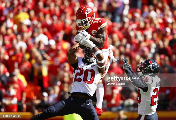 Tyreek Hill of the Kansas City Chiefs makes a 46yard touchdown reception against Justin Reid and Phillip Gaines of the Houston Texans during the...