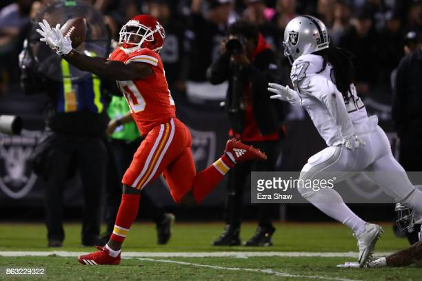 Tyreek Hill of the Kansas City Chiefs makes a 64yard catch for a touchdown against the Oakland Raiders during their NFL game at OaklandAlameda County...