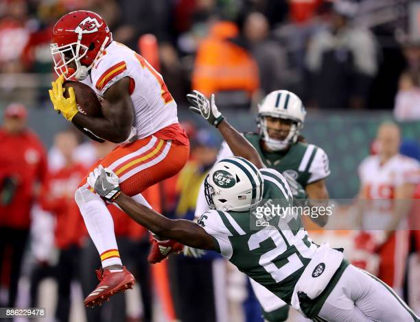 Tyreek Hill of the Kansas City Chiefs makes a catch in the final minutes of the game as Marcus Maye of the New York Jets defends on December 03 2017...