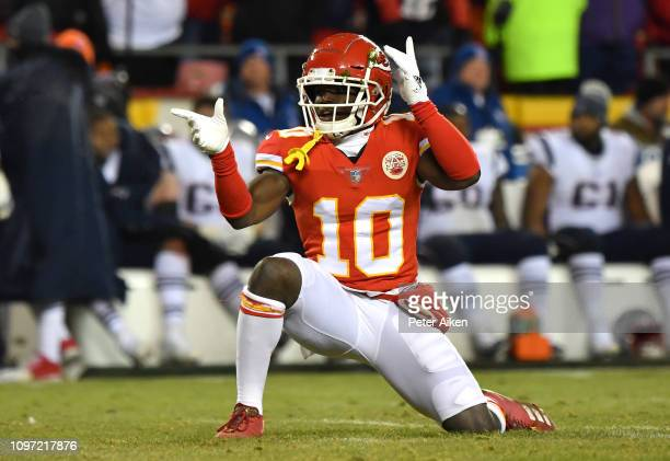 Tyreek Hill of the Kansas City Chiefs reacts after a catch in the second quarter against the New England Patriots during the AFC Championship Game at...