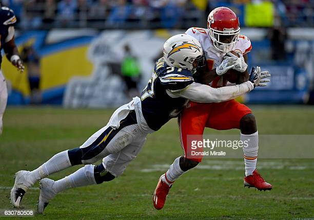 Tyreek Hill of the Kansas City Chiefs runs against the tackle of Jatavis Brown of the San Diego Chargers en route to the Chargers 3727 loss to the...