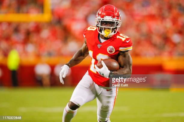 Tyreek Hill of the Kansas City Chiefs runs for a 12yard gain in preseason action against the San Francisco 49ers at Arrowhead Stadium on August 24...