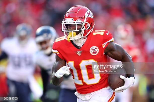 Tyreek Hill of the Kansas City Chiefs runs for a 7 yard touchdown in the first quarter against the Tennessee Titans in the AFC Championship Game at...