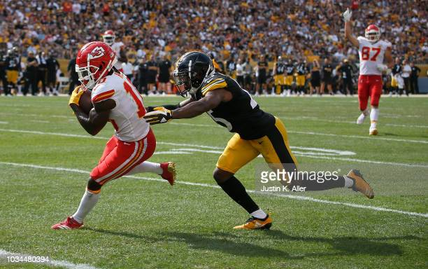 Tyreek Hill of the Kansas City Chiefs runs into the end zone past Artie Burns of the Pittsburgh Steelers for a 29 yard touchdown reception in the...