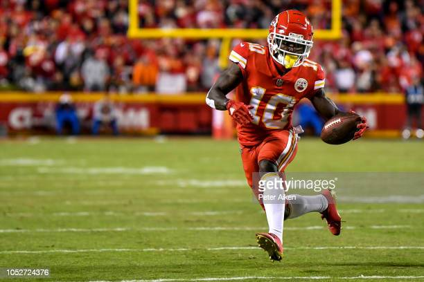 Tyreek Hill of the Kansas City Chiefs runs towards the sideline during the first half of the game against the Cincinnati Bengals at Arrowhead Stadium...