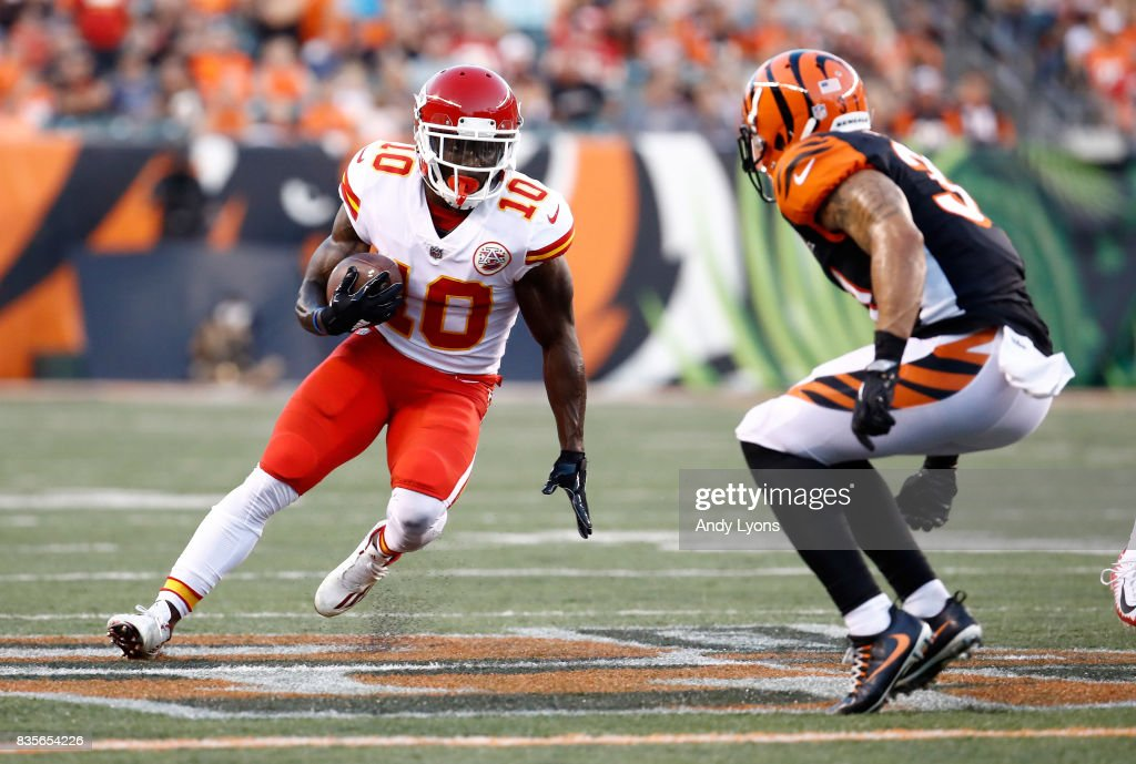 Tyreek Hill #10 of the Kansas City Chiefs runs with the ball against the Cincinnati Bengals during the preseason game at Paul Brown Stadium on August 19, 2017 in Cincinnati, Ohio.