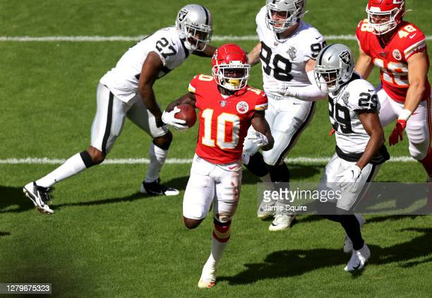 Tyreek Hill of the Kansas City Chiefs scores a touchdown against the Las Vegas Raiders during the first quarter at Arrowhead Stadium on October 11,...