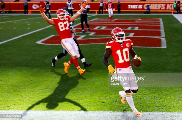Tyreek Hill of the Kansas City Chiefs scores a touchdown against the Carolina Panthers in the fourth quarter at Arrowhead Stadium on November 08,...