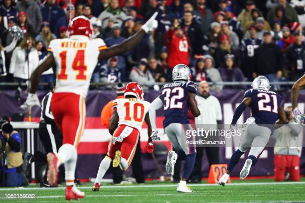 Tyreek Hill of the Kansas City Chiefs scores a touchdown in the fourth quarter of a game against the New England Patriots at Gillette Stadium on...