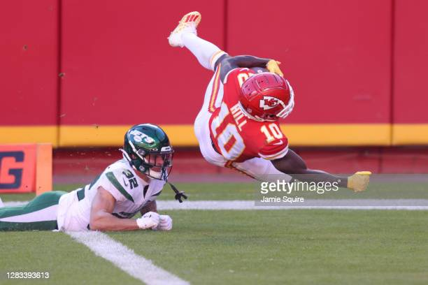 Tyreek Hill of the Kansas City Chiefs scores on a 41-yard touchdown against the New York Jets during their NFL game at Arrowhead Stadium on November...