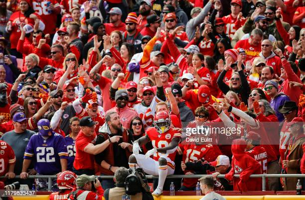 Tyreek Hill of the Kansas City Chiefs sits on the railing of the lower level at Arrowhead Stadium after Hill's 40-yard touchdown catch in the first...