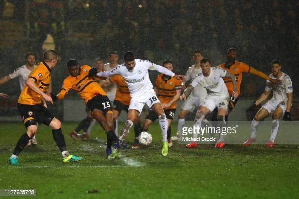 Tyreeq Bakinson of Newport County and Ashely Fletcher of Middlesbrough compete for the ball during the FA Cup Fourth Round Replay match between...
