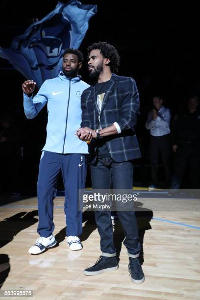 Tyreke Evans and Mike Conley of the Memphis Grizzlies speak to fans before the game against the San Antonio Spurs on December 1 2017 at FedExForum in...