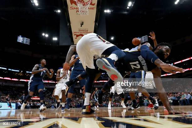 Tyreke Evans of the Memphis Grizzlies falls to the ground after being blocked by DeMarcus Cousins of the New Orleans Pelicans during the second half...