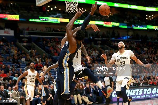 Tyreke Evans of the Memphis Grizzlies is blocked by DeMarcus Cousins of the New Orleans Pelicans during the second half of a NBA game at the Smoothie...