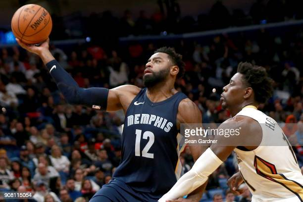Tyreke Evans of the Memphis Grizzlies shoots over Jrue Holiday of the New Orleans Pelicans during the second half of a NBA game at the Smoothie King...