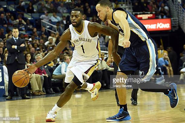 Tyreke Evans of the New Orleans Pelicans drives around Tayshaun Prince of the Memphis Grizzlies during a game at the Smoothie King Center on January...